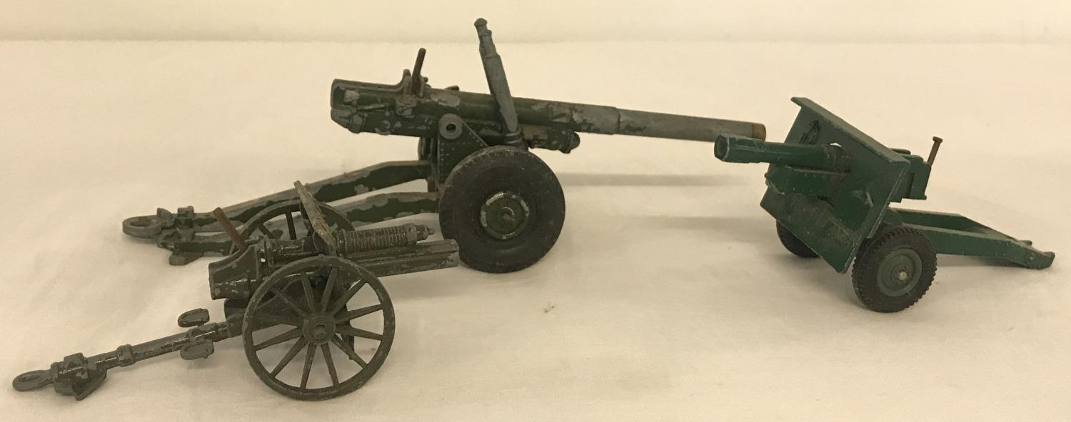 Lot 179 - 2 diecast model military field guns by Crescent together with a military field gun by Britains Ltd.