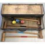 A vintage wooden cased part croquet set; comprising 4 mallets and 4 coloured balls.