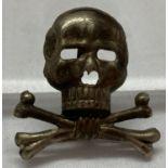 A German WWII style Brunswick Regiment Skull badge.