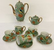 A vintage Japanese 13 piece coffee set with floral and bird detail.