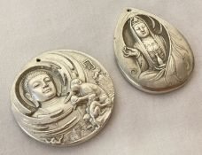2 Chinese white metal, double sided pendants depicting Oriental Deities.