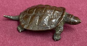 A small Chinese bronze figure of a turtle, signed to underside.