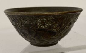 A small Chinese bronze bowl with elephant detail to outer bowl.