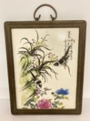 A signed porcelain Chinese ceramic plaque depicting birds and flowers.