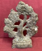 A hollow bronze figurine of a Chinese coin tree.