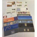 A collection of Royal Mail collectors stamp sets, with information cards.