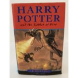 """A hardback copy of """"Harry Potter and the Goblet of Fire"""" by J.K. Rowling, printed by Omnia Books."""