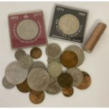 A small collection of British and foreign coins. To include crowns & a sealed roll of ½ pence coins.
