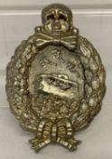 A WWI style tank crew (Weimar Republic) silver tone badge.