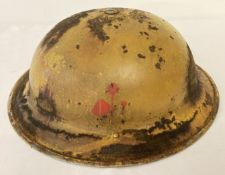 A WWII style experimental coloured British brodie helmet.