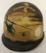 A Vietnam War era US MI helmet with post war 101st Airborne memorial hand painted detail.
