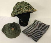 A Vietnam War era Viet Cong fibre helmet, cap and scarf.