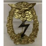 A WWII style German Luftwaffe 25 assults badge.