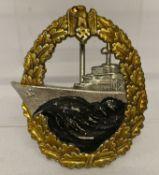 A WWII style German Kreigsmarine destroyer badge with eagle and oak leaf detail.