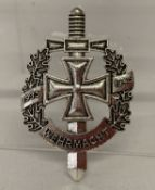 A WWII style German Wehrmacht service pin back badge.