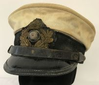 A WWI style Imperial German U-Boat Captains visor cap.