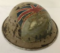 A WWII style British Brodie helmet with post war hand painted 8th Army memorial detail.