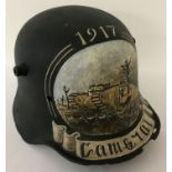 A WWI style German Stahlhelm helmet with post war memorial painting referencing Cambrai, 1917.