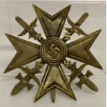 A WWII style Spanish Cross with swords bronze award.