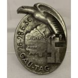 A WWII style Gau Tag Koblenz metal badge with eagle detail.