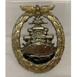 A WWII style German Kreigsmarine high seas fleet badge.
