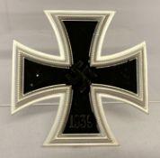 A reproduction Iron Cross tunic badge.