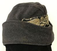 A German WWII style Luftshutz (Air Raid Police) side cap with embroidered badge.