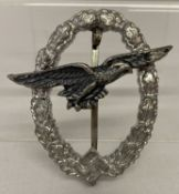 A WWII style Luftwaffe glider badge with eagle and oak leaf detail.