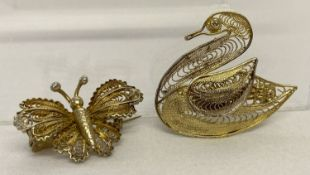2 silver gilt filigree brooches in the shape of a swan and a butterfly.