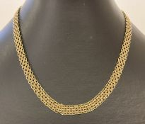 A 9ct gold vintage style decorative flat chain necklace with lobster clasp.