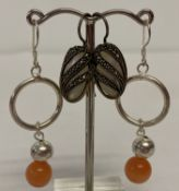 2 pairs of silver drop style earrings. A pair set with mother of pearl with marcasite set overlays.