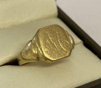 A men's 18ct gold cut through signet ring suitable for scrap.