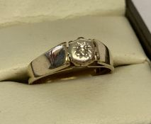 A vintage 9ct gold illusion set solitaire diamond ring.