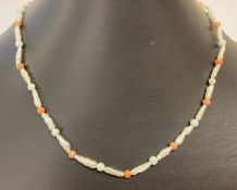 A baroque pearl, turquoise and coral bead necklace with 9ct gold clasp.