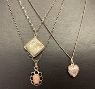 3 silver necklaces. A diamond shaped locket with floral engraving on a fine belcher chain.