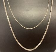 2 silver chain necklaces. A 20 inch fine snake chain together with a 23 inch box chain.
