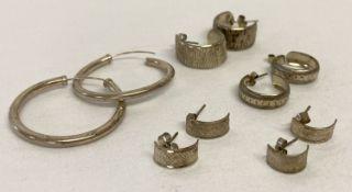 5 pairs of silver and white metal vintage hoop style earrings.