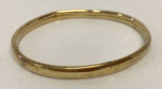 A 9ct scrap gold bangle.