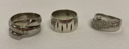 3 silver band style dress rings.
