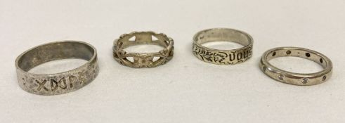 4 silver band style rings. To include a clear stone set full eternity ring.