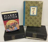 A first edition of Harry Potter and the Deathly Hallows without dust cover, damage to one corner.