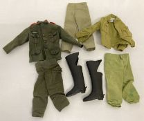 A small collection of vintage Palitoy Action Man military uniform.