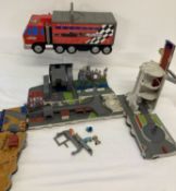 2 x large Hasbro Toys Micro Machines fold out truck playsets.