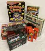 A collection of boxed games and toys to include Bingo Lotto, Texas Hold'Em Poker set.