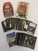 A collection of assorted Harry Potter card games and trading cards.