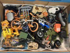 A box of modern Action Man weapons and accessories.