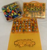 A collection of 220+ vintage Gogo's Crazy Bones figures and 2 carry cases.