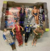 A box of assorted Action Man dolls, toys and accessories.