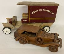 """A large wooden model of a van marked """"Whatnot And Thingummy Ltd""""."""