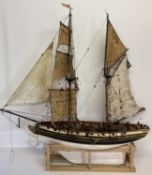 A scratch built pirate ship pond yacht with sails, rigging, figure, stand and internal workings.